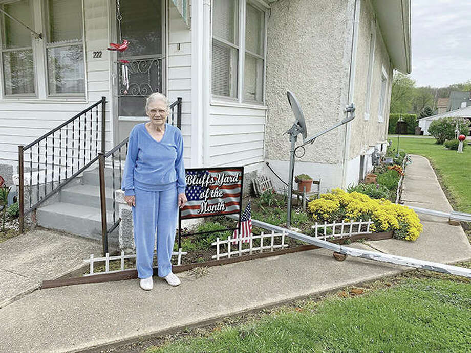 From March through October, a Bluffs yard is chosen each month to be honored for its appearance. The village started this about five years ago to encourage people to take care of their houses and yards. This month, the yard of 92-year-old Kate Christison was selected. She spends most mornings grooming and caring for her yard and her neighbors are appreciative of her hard work and friendly ways. Photo: Photo Provided