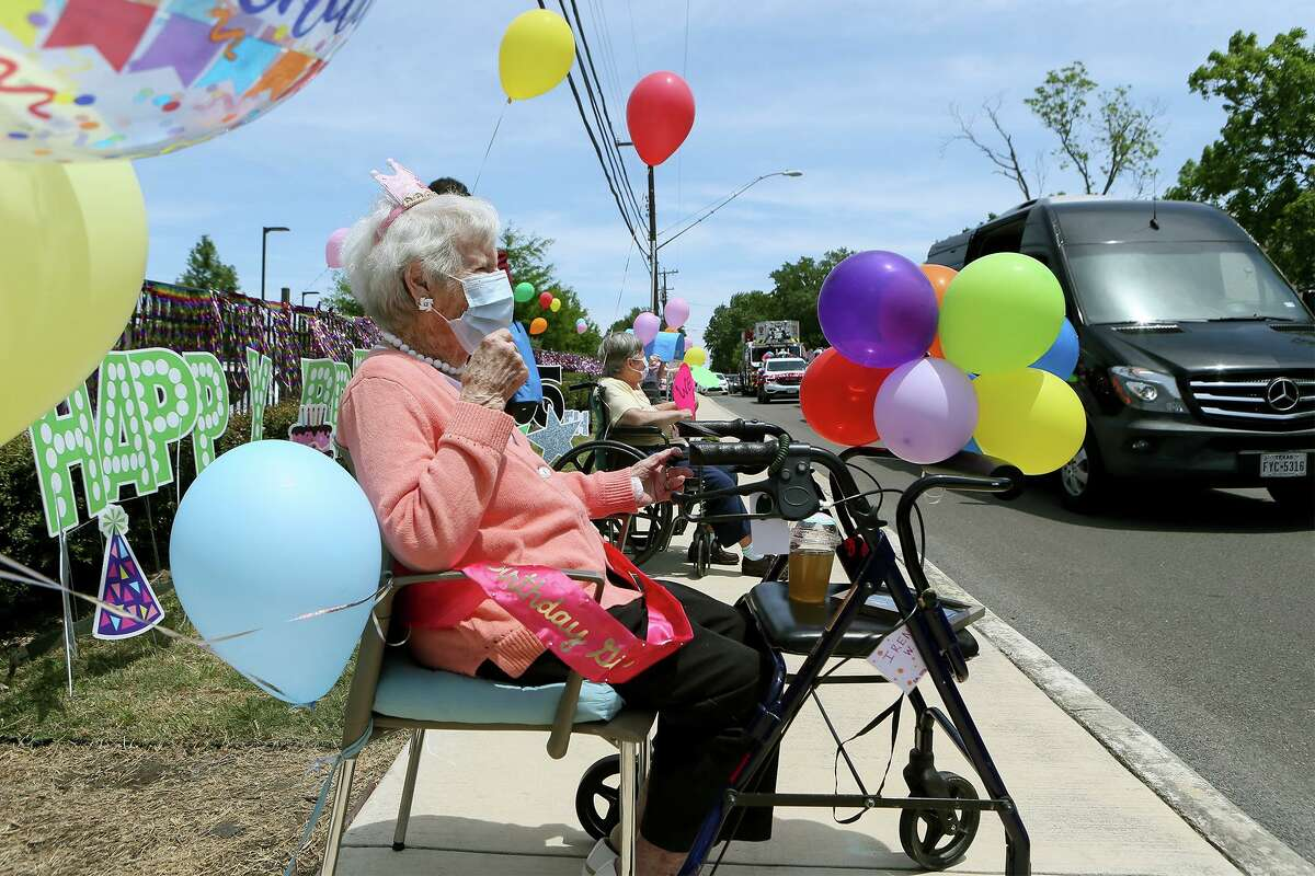 The staff at Franklin Park Senior Community surprises Irene Wilson, left, with a parade that included a San Antonio Fire Department fire truck on her 105th birthday on Wednesday, April 29, 2020.