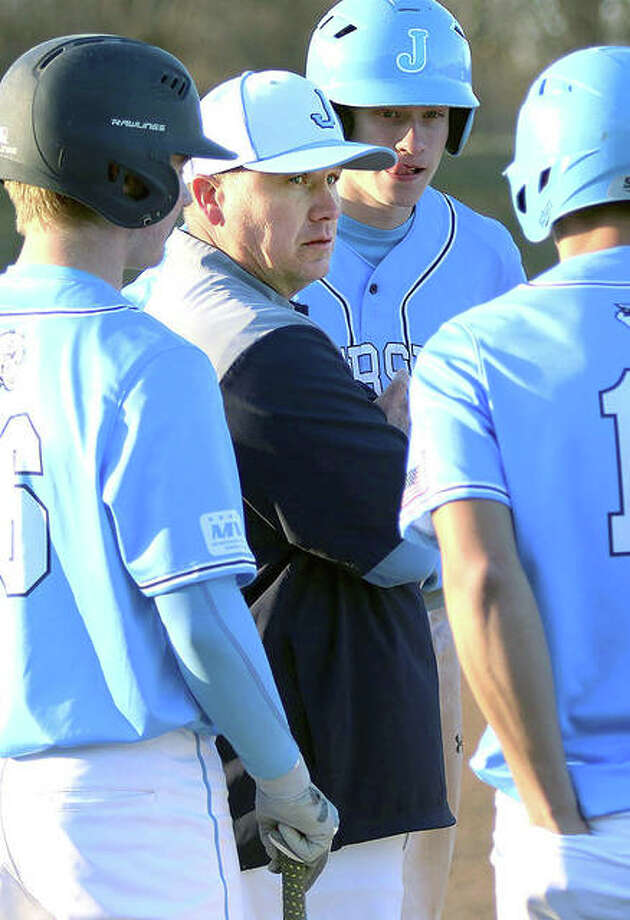 Jersey coach Darren Perdun talks with some of his Panthers at third base during a break in play in a game last season at Alton High in Godfrey. Photo: Greg Shashack / Hearst Illinois