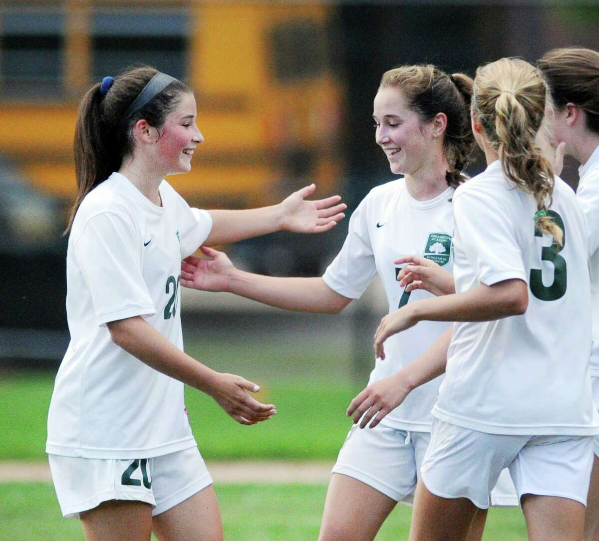Taylor Lane, (#20), left, and Katie Goldsmith, (#3), right, congratulate their Greenwich Academy teammate Tessa Brooks, center, after Brooks scored a goal during the first half of the girls high school soccer match between King School and Greenwich Academy at King in Stamford, Conn., Thursday, Sept. 14, 2017. GA defeated King, 6-0.