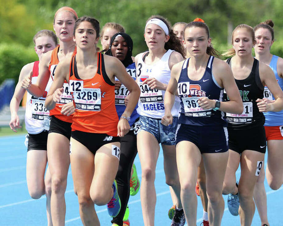 Edwardsville's Abby Korak (front left) leads a pack of runners in the 1,600 meters at the Class 3A state meet last May as a junior at Eastern Illinois' O'Brien Stadium in Charleston. Korak, who placed eighth in the race to become the Tigers' first state medalist in the event, was coming off an injury that knocked out her senior cross country season and was denied a senior comeback in track this spring. Photo: Greg Shashack / The Telegraph