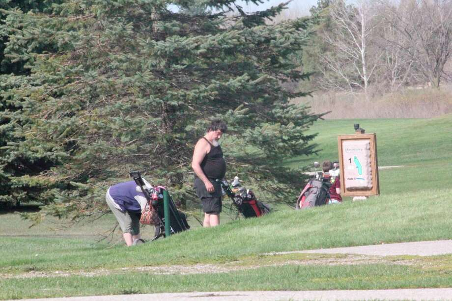Golfers prepare to tee off at hole No. 1 on Saturday at Birch Valley Golf Course in Evart. (Pioneer photoi/John Raffel)