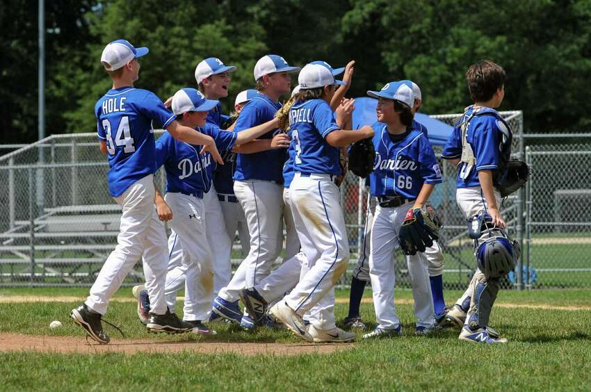 Darien celebrates a 7-4 victory over Fairfield American to move onto the Section 1 finals.