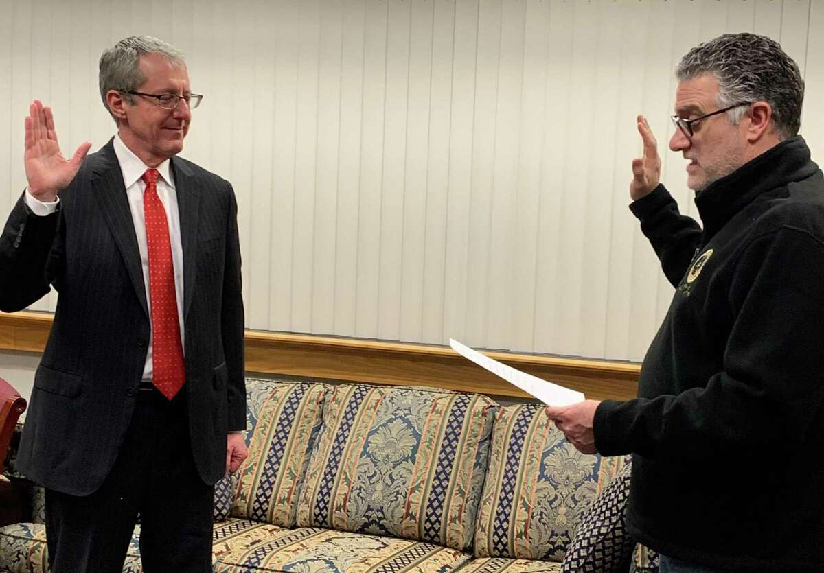 Paul Ferencek (left) being sworn in as the head prosecutor of the Stamford-Norwalk Judicial District by Chief State's Attorney Richard Colangelo on Friday morning in Hartford.