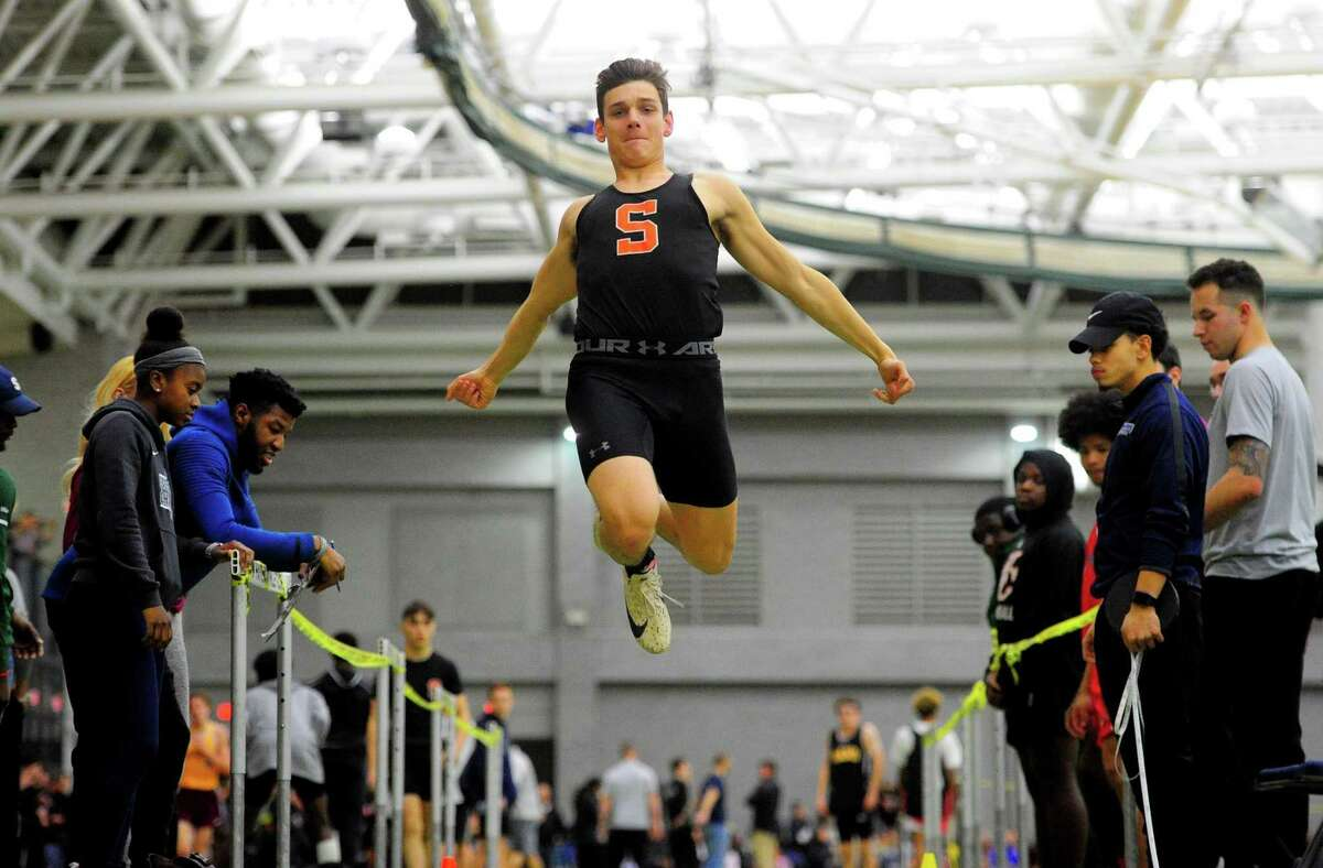 Shelton's David Niski competes in the long jump during SCC Indoor Track and Field Championship action in New Haven, Conn., on Friday Feb. 7, 2020.