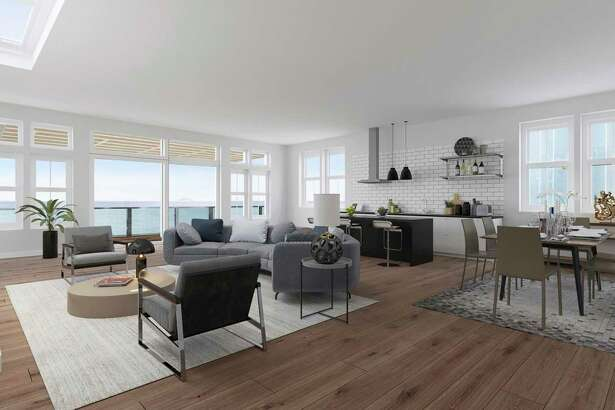 In this virtually renovated image, the rendering of this living room in Sausalito showcases wide-plank hardwood floors, a skylight, an open kitchen and a glass door opening to a terrace.