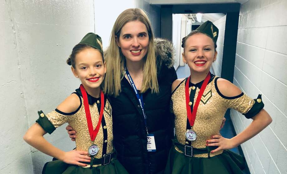 Terri Haag poses with 11-year-old Julia Miranda and 13-year-old Ciarra Franklin at the 2019 Julia-Ciarra Showcase. Photo: Photo Provided