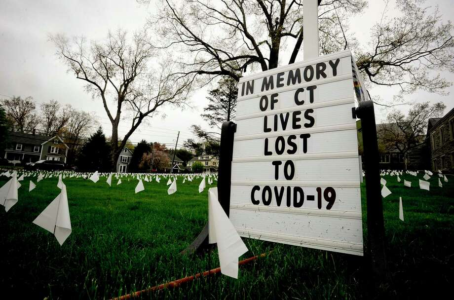 Thousands of white markers are placed on the lawn surrounding the First Congregational Church of Greenwich on April 29, 2020 to honor the many lives lost as result of the COVID-19 pandemic. Photo: Matthew Brown / Hearst Connecticut Media / Stamford Advocate