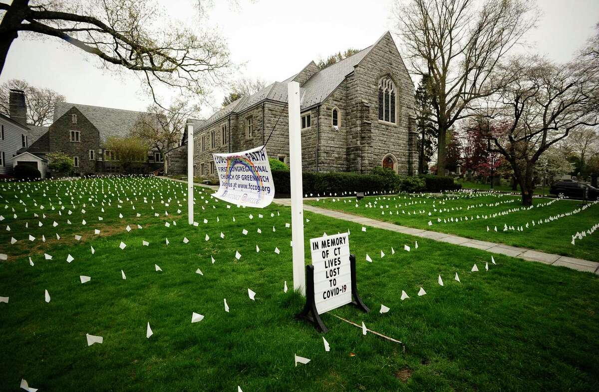 Thousands of white markers are placed on the lawn surrounding the First Congregational Church of Greenwich on April 29, 2020 to honor the many lives lost as result of the COVID-19 pandemic.