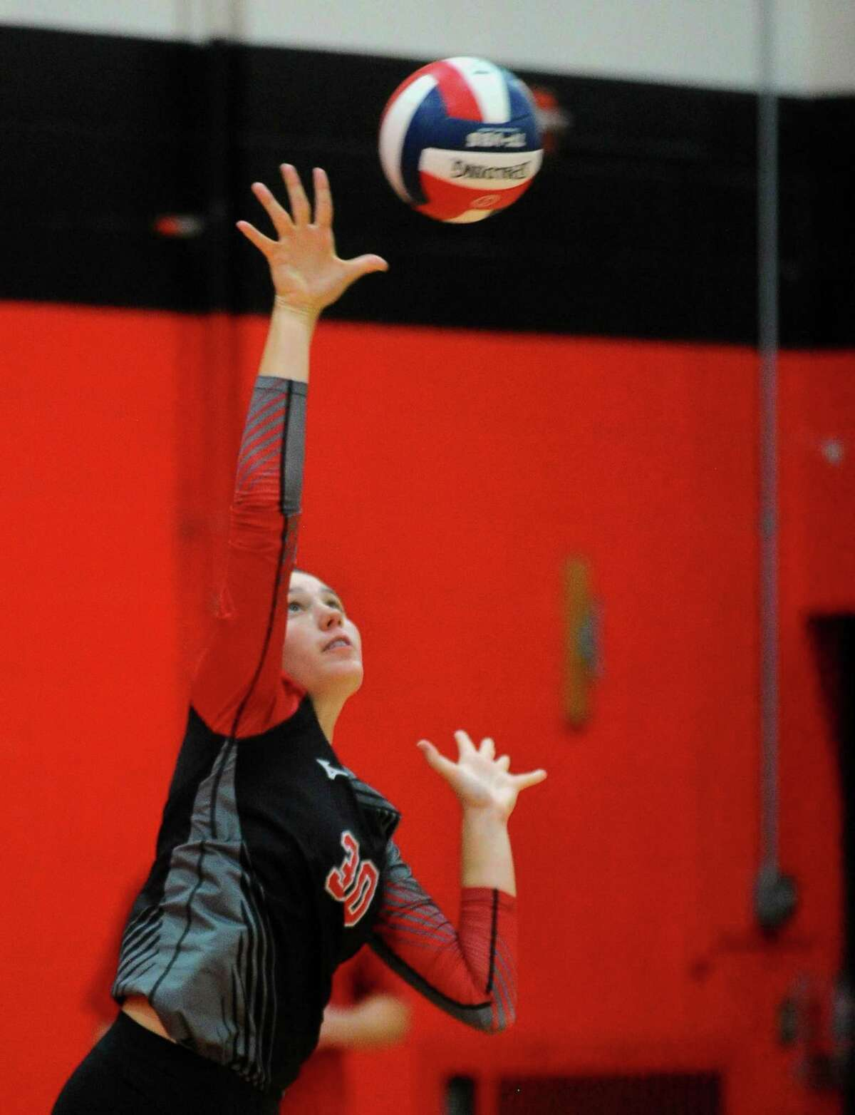 Cheshire's Lindsey Abramson serves the ball during girls volleyball action against Amity in Cheshire, Conn., on Thursday Sept. 19, 2019.