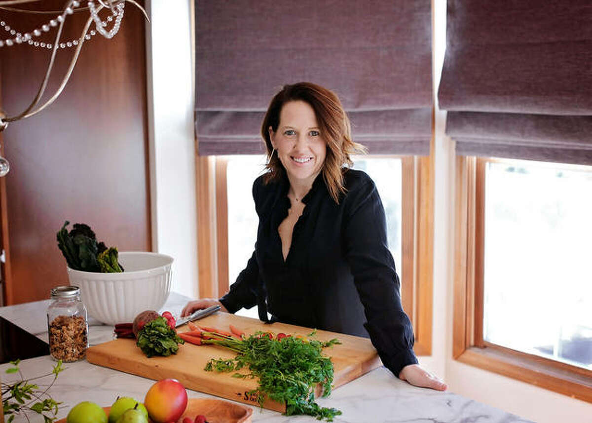 Susan Smith in her kitchen as she works on creating another meal for her Plan Shop Live healthy gourmet eatery.