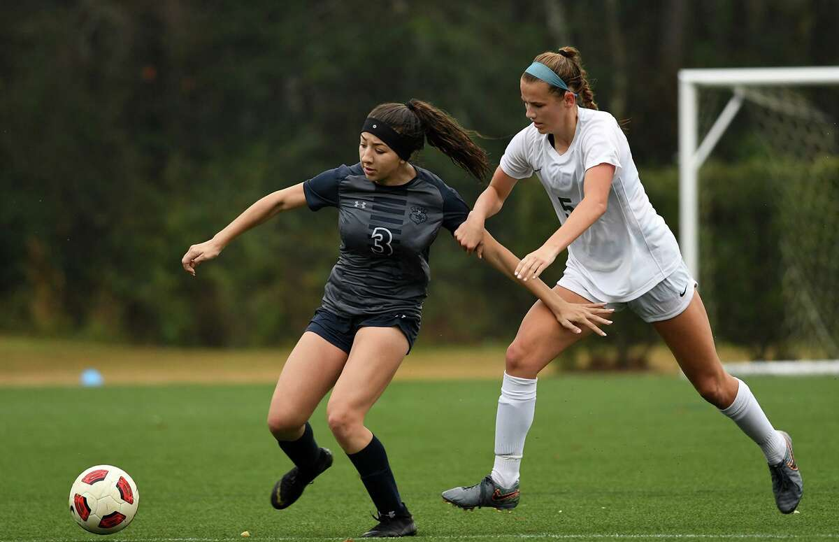 The Woodlands junior Katie Koehler, right, is The Courier's Player of the Year.