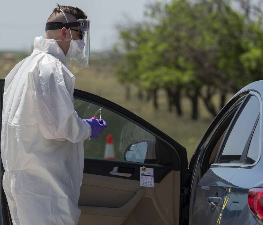 Sgt. Jon Murphy, medic with the 2nd 142nd INF out of Lubbock, TX, conducts the nasal swab as he and other members of the Texas Military Forces, including the Texas Army National Guard, Texas Air National Guard, and Texas State Guard, conduct coronavirus testing 05/03/2020 at the Greenwood Volunteer Fire Department. The testing is free and open to anyone, but appointments had to be made in advance. Tim Fischer/Reporter-Telegram Photo: Tim Fischer/Midland Reporter-Telegram