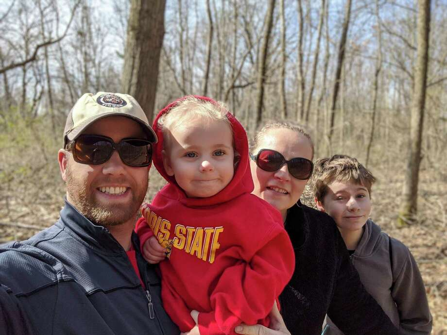 Big Rapids City Commissioner Jonathan Eppley and his family hike in Clay Cliffs. From left, Eppley; his 3-year-old daughter, Madeline; his wife, Megan; and 11-year-old son, Alex. (Courtesy photo)