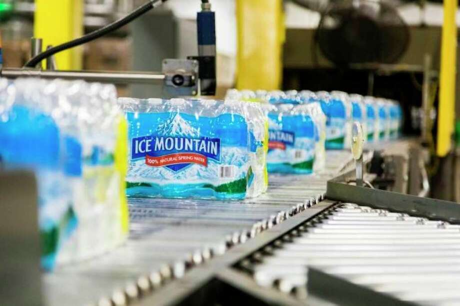 Nestlé Waters North America Ice Mountain brand bottled water is seen on the production line at the Ice Mountain production facility in Stanwood. Water from the company's White Pine Springs well in Osceola Township is transported to the facility for bottling. Nestle has received approval to increase its withdrawal from the White Pine Springs well from 250 gpm to 400 gpm. (Pioneer file photo)