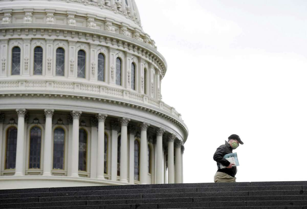 A person walks near the United States Capitol on Monday April 27, 2020.