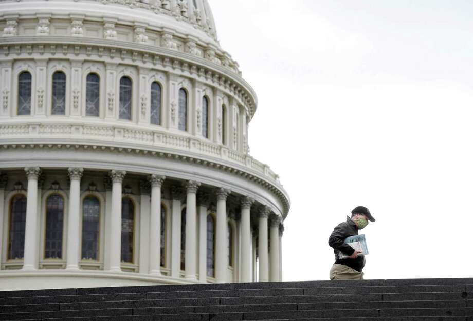 A person walks near the United States Capitol on Monday April 27, 2020. Photo: Washington Post Photo By Matt McClain / The Washington Post