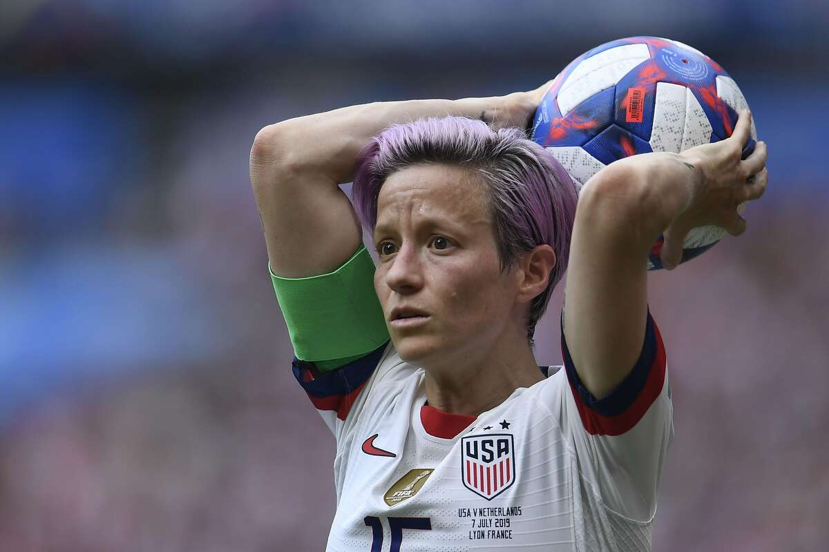 (FILES) In this file photo taken on July 7, 2019 United States' forward Megan Rapinoe takes a throw in during the France 2019 Womens World Cup football final match between USA and the Netherlands, at the Lyon Stadium in Lyon, central-eastern France. - A federal judge dismissed the United States women's soccer team's bid for equal pay on May 1, 2020, rejecting claims the players had been underpaid in a crushing defeat for the reigning world champions. (Photo by CHRISTOPHE SIMON / AFP) (Photo by CHRISTOPHE SIMON/AFP via Getty Images)