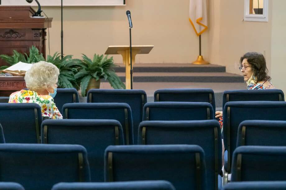 Two ladies chat before the start of the service while socially distancing themselves. Trinity Baptist Church opened the doors of their sanctuary on Sunday for their first in-person service since the COVID-19 pandemic shut everything down. Photo made on May 3, 2020. Fran Ruchalski/The Enterprise Photo: Fran Ruchalski/The Enterprise / ? 2020 The Beaumont Enterprise
