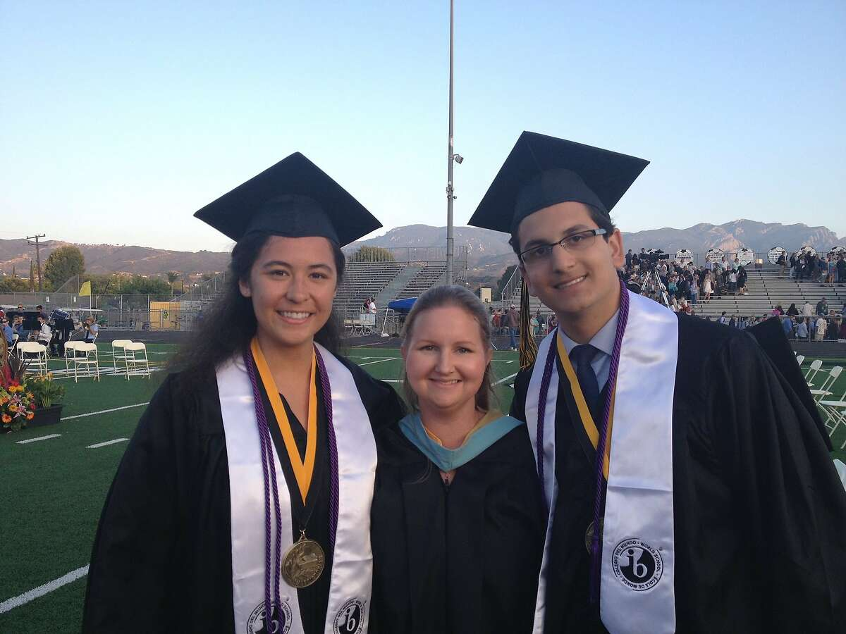 Courtney Brousseau, pictured at right, on the evening he graduated from Newbury Park High School in 2015 in Newbury Park, Calif. Brousseau is clinging to life in a San Francisco hospital after being shot in a drive-by shooting in San Francisco's Mission district Friday, May 1, 2020. Brousseau is pictured with classmate Grace O'Toole, who co-edited the school's Panther Prowler newspaper with Brousseau. Between them is newspaper faculty advisor Michelle Saremi.