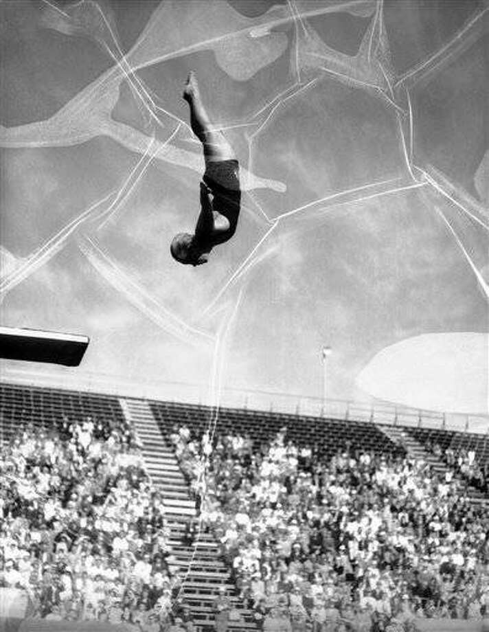 Miss Georgia Coleman at a Los Angeles, California, pool on May 4, 1932, as she demonstrated just exactly why she is the national 10-foot diving board champion. Miss Coleman clearly demonstrates that artistry is very much at home in the realm of swimming and diving. (AP Photo)