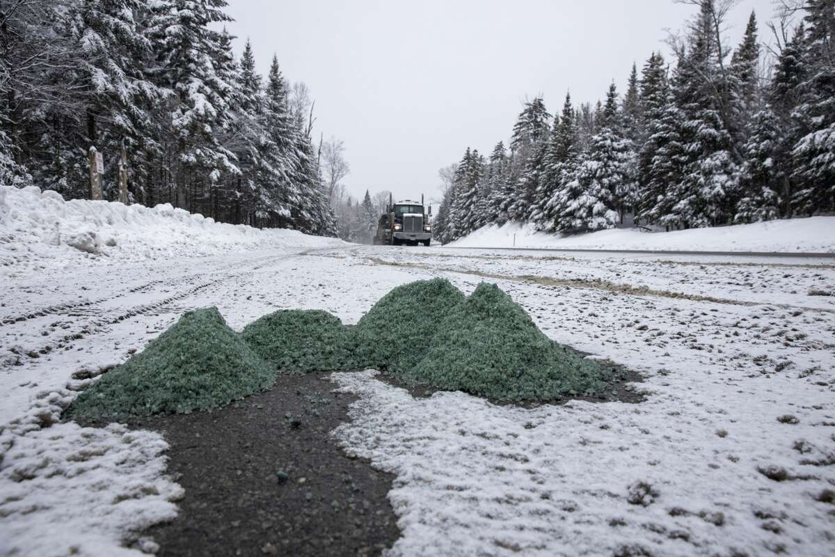 Salt piles up on a Cascade Mountain parking area along Route 73 early this year. Meant to improve traffic safety, the state's application on highways also contaminates drinking wells, and owners have difficulty getting help combating the pollution. Photo by Mike Lynch
