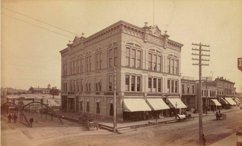 The Engelmann building that was located at the corner of River and Maple streets next to the Maple Street Bridge is shown in this 1890s photograph.