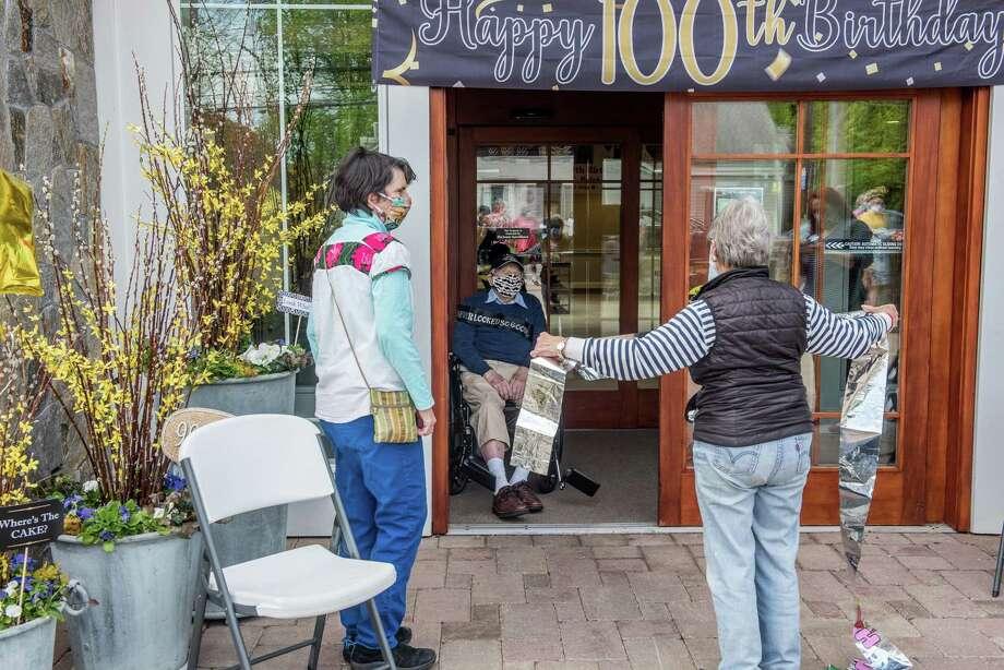 Darien joined together to honor JJ Jinishian's 100th birthday on Saturday, May 2. Photo: Bryan Haeffele/Hearst Connecticut Media / BryanHaeffele