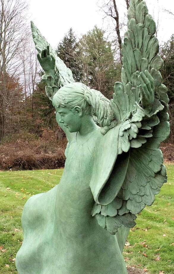 The Angel of Freedom statue after bronze patination.