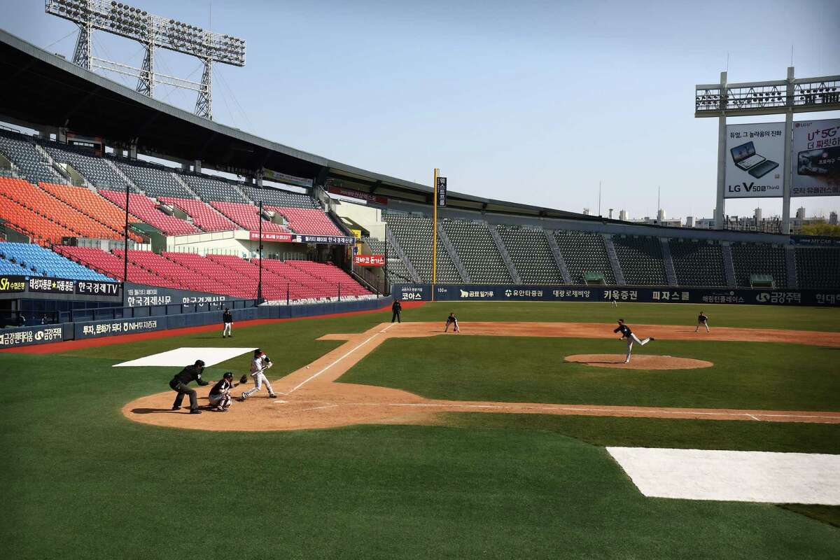 ESPN will televise Korean Baseball Organization games beginning Tuesday. The games will be played in empty stadiums, like this intrasquad game last month in Seoul's Jamsil area.