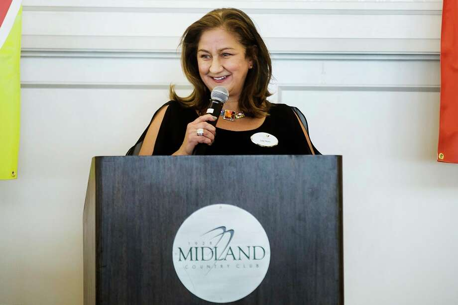 Julie Nunn, executive director for Cancer Services of Midland, speaks during the organization's 28th Annual Holiday Luncheon & Style Show Wednesday, Dec. 4, 2019 at Midland Country Club. (Katy Kildee/kkildee@mdn.net)