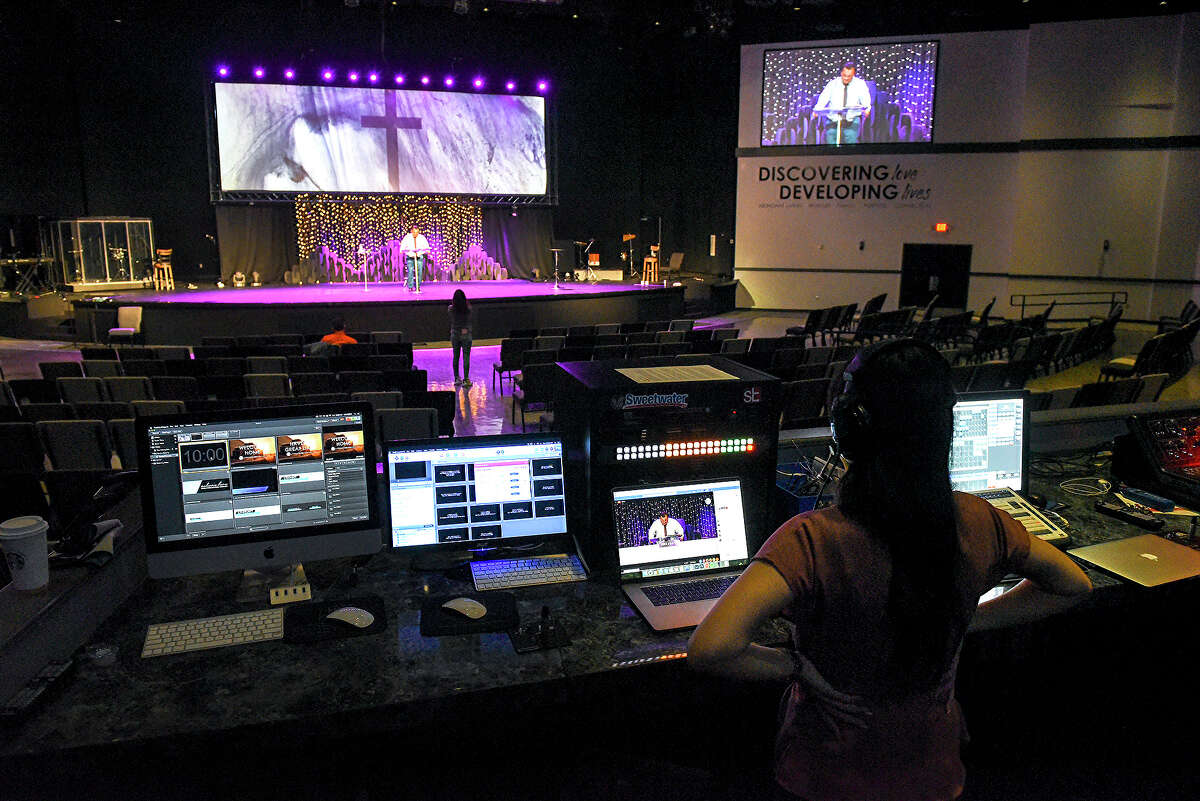 The Laredo First Assembly church Lead Pastor's Assistant Terry Jarrell helps produce an online Easter Sunday service in their empty hall, Sunday, Apr. 12, 2020, as social gatherings remain prohibited due to the COVID-19 coronavirus pandemic.