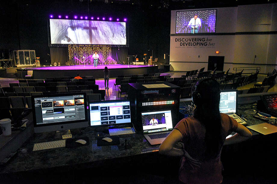 The Laredo First Assembly church Lead Pastor's Assistant Terry Jarrell helps produce an online Easter Sunday service in their empty hall, Sunday, Apr. 12, 2020, as social gatherings remain prohibited due to the COVID-19 coronavirus pandemic. Photo: Danny Zaragoza/Laredo Morning Times