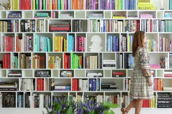 This wall of bookshelves was created for homeowners who are voracious readers and own a major book collection.