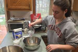 Features editor Sara Tracey blooming yeast in warm water at the onset of making focaccia.