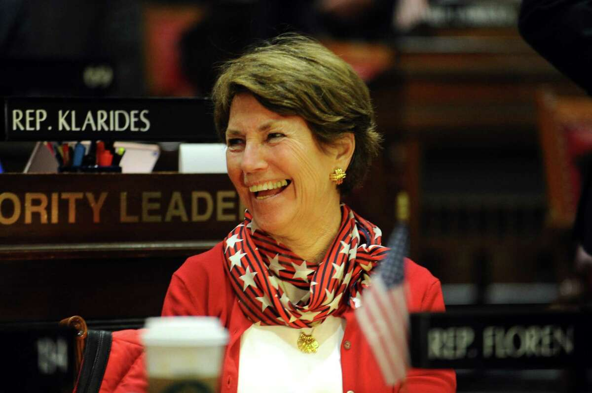 Rep. Livvy Floren, R-Greenwich and Stamford, smiles during the Connecticut State Legislature's first session of the year inside the House chamber of the State Capitol in Hartford, Conn. on Wednesday, Feb. 7, 2018.