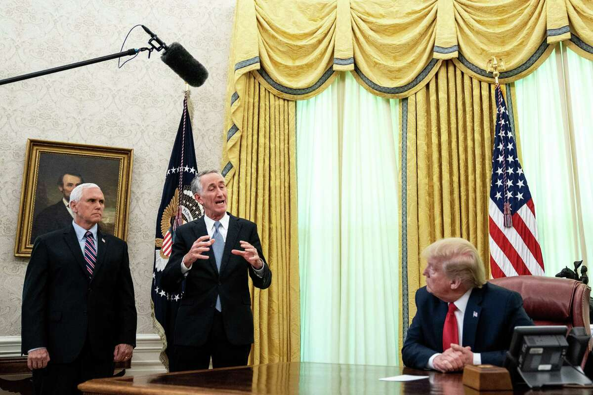 U.S. President Donald Trump, right, is joined by Gilead Sciences Chairman and CEO Daniel O'Day and Vice President Mike Pence to announce the FDA issued an emergency approval for the antiviral drug remdesivir at the White House May 1 in Washington, D.C.