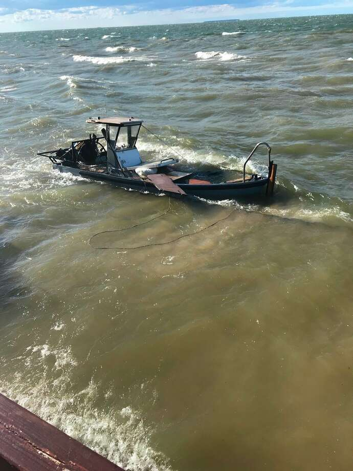 One tow boat was destroyed during the recover of a vintage wooden Chris-Craft boat. (Huron County Sheriff's Office/Courtesy Photo)