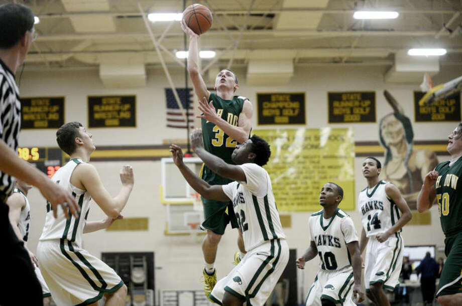 Dow High's Alec Marty gets airborne during a March 13, 2014 district game vs. Saginaw Heritage. Photo: Daily News File Photo