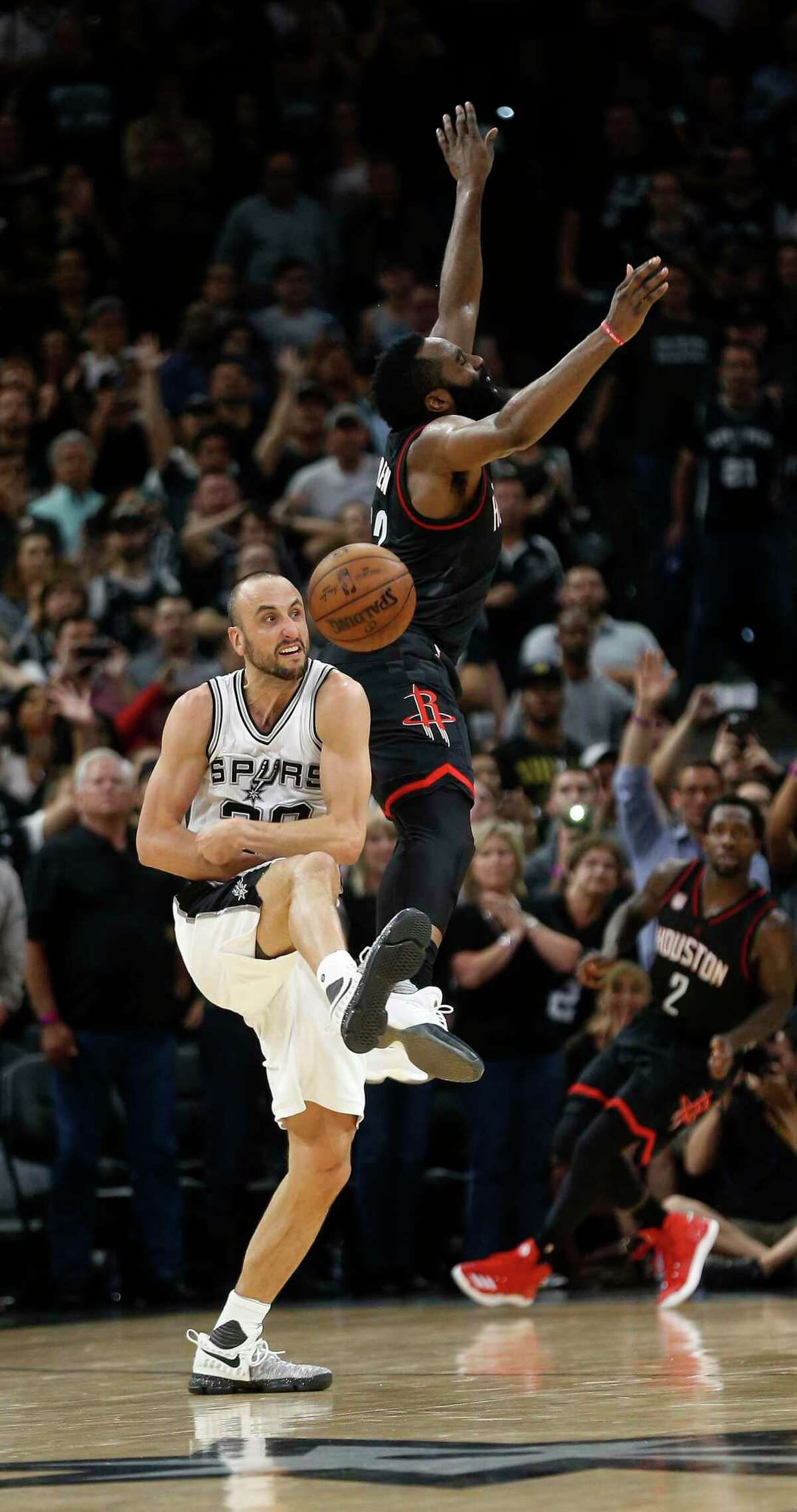 Spurs guard Manu Ginobili (20) swats the ball from Houston Rockets guard James Harden (13) in the final seconds during overtime of Game 5 of the second round of the Western Conference NBA playoffs at AT&T Center on May 9, 2017, in San Antonio.