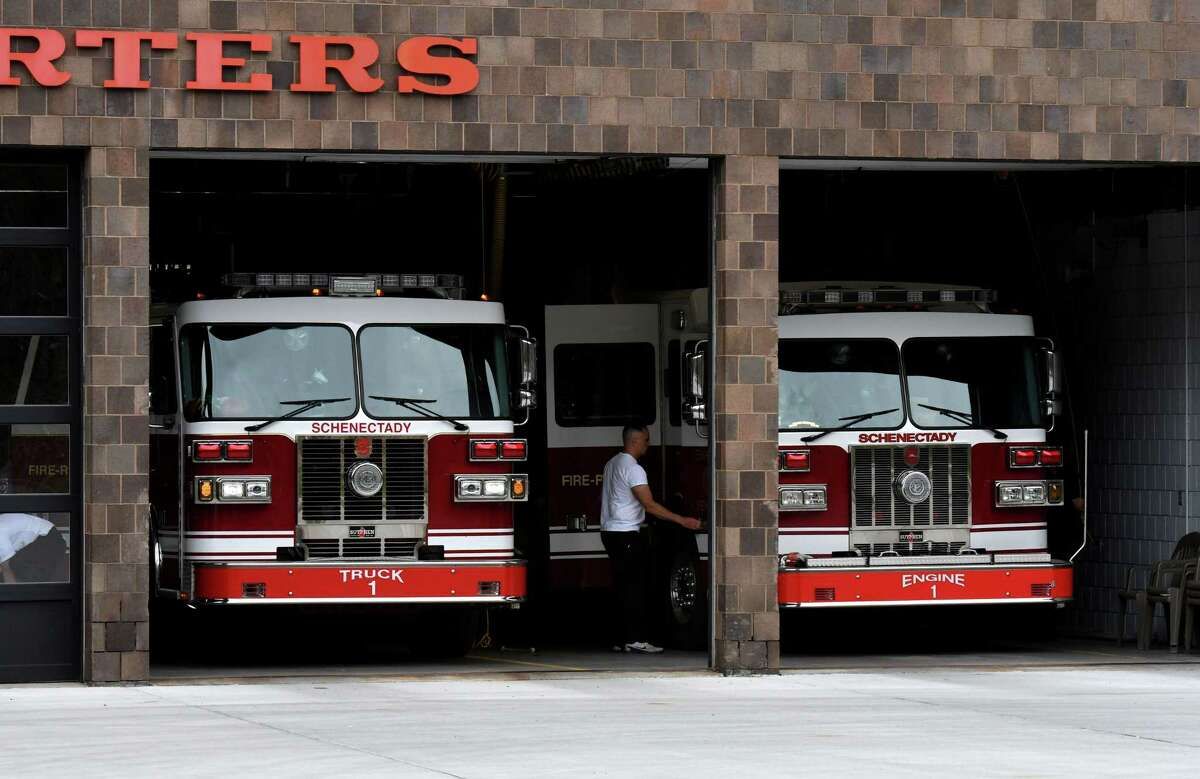 A Schenectady firefighters leave for a call from the city headquarters station on Monday, May, 4, 2020, in Schenectady, N.Y. Mayor Gary McCarthy suggested that police and firefighters will need to be laid off to cover a loss of government aid. (Will Waldron/Times Union)
