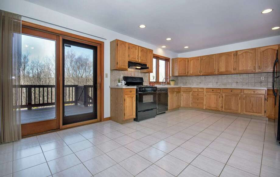 On the first floor there is a 1,200-square-foot, two-bedroom in-law apartment with a large kitchen and a door to a deck.