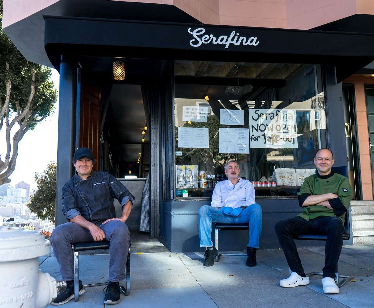 Serafina chef-ownerMaurizio Bruschi (left), co-ownerGiuseppe Terminiello andchef Umberto Cannarsa sit outside their new San Francisco restaurant, which is open for takeout during shelter in place.