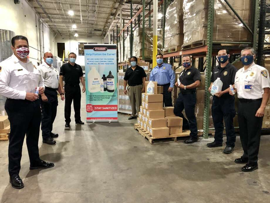 Houston Fire Department Chief Sam Pena and many of his team members stopped by Stringer Chemical headquarters on Friday, May 1 to pick up the 1,000 bottles of hand sanitizer donated for first responders, firefighters, and paramedics. Photo: Courtesy Of Stinger Chemical