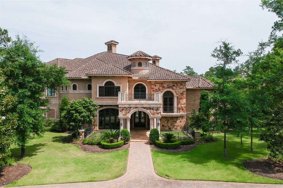 The Mediterranean-style home at 7 Fleury Way in The Woodlands spans 14,636 square feet and features several luxury amenities. Photo: Houston Association Of Realtors