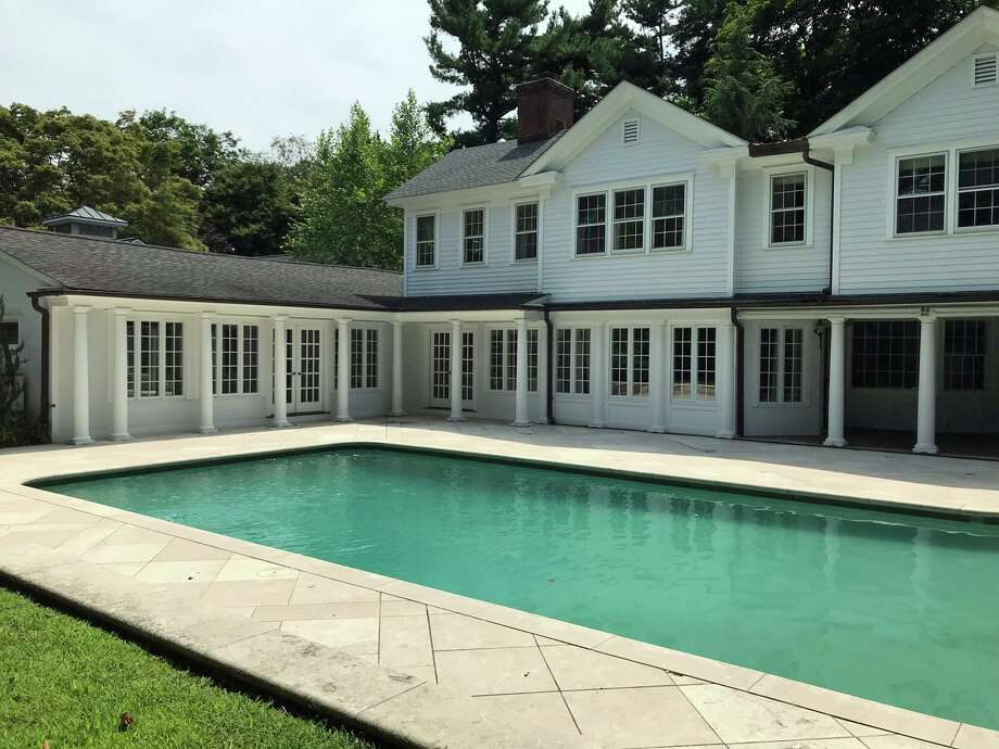 This two-acre property features an in-ground swimming pool.