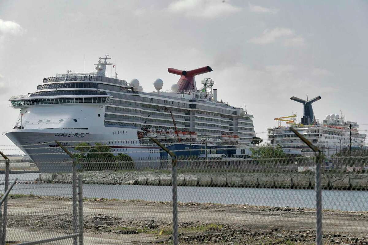 FILE - In a Thursday, March 26, 2020 file photo, Carnival Cruise ships are docked at the Port of Tampa in Tampa, Fla. Carnival Cruise Lines says it plans to gradually resume cruising in North America in August, nearly five months after it halted operations due to the new coronavirus. Sailings will begin on Aug. 1 with eight ships setting off from Galveston, Texas; Miami; and Port Canaveral, Florida. (AP Photo/Chris O'Meara, File)