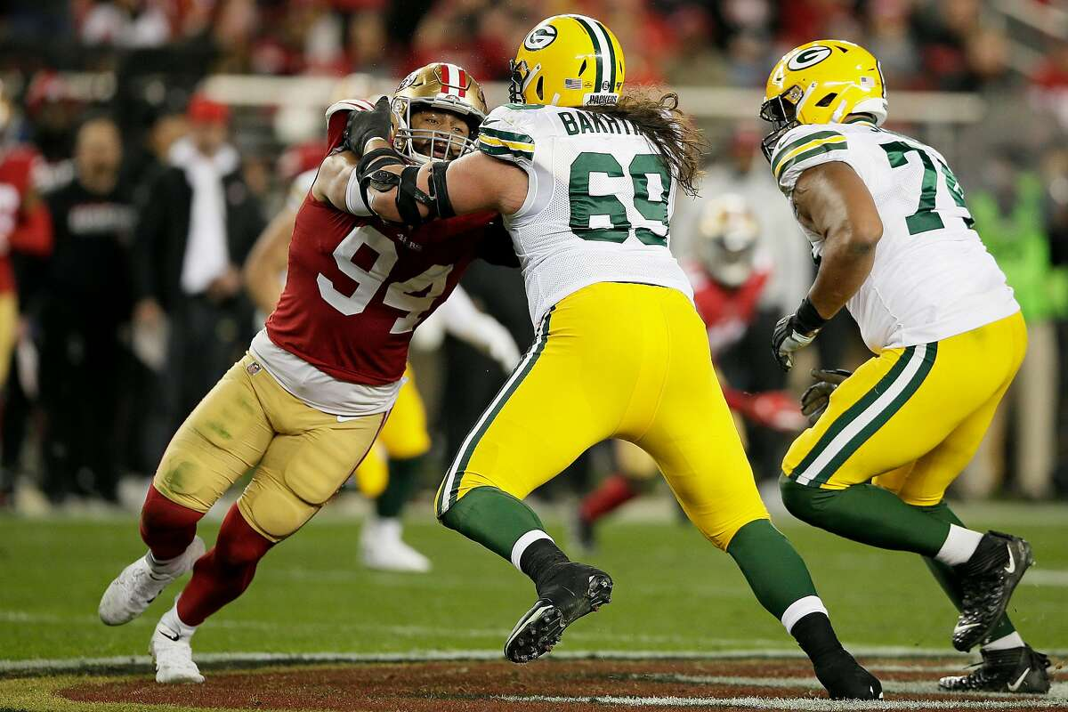 San Francisco 49ers defensive end Solomon Thomas (94) is defended by Green Bay Packers offensive tackle David Bakhtiari (69) in the NFC Championship Game at Levi's Stadium, Sunday, Jan. 19, 2020, in San Francisco, Calif. The San Francisco 49ers won 37-20 against the Green Bay Packers. The 49ers will play the Kansas City Chiefs in the Super Bowl.