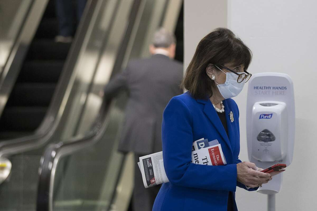 Rep. Jackie Speier, D-Calif., walks past a hand sanitizing station as she walks back to congressional offices on Capitol Hill, Thursday, April 23, 2020, in Washington. The House is expected to vote on a nearly $500 billion Coronavirus relief bill. (AP Photo/Andrew Harnik)