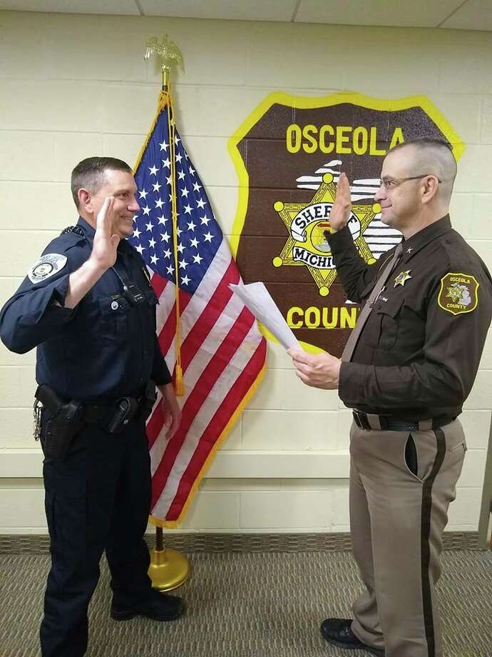 Osceola County Sheriff Ed Williams (right) deputized Reed City Chief of Police Christopher Lockhart on Friday. Lockhart said he is excited to be working in the community he grew up in. (Courtesy photo)